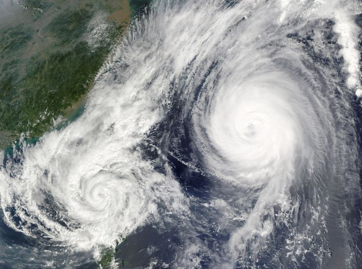 On Oct. 3, 2009 NASA's Aqua and Terra satellites captured this image of two powerful storms in the South China Sea near the Philippines.