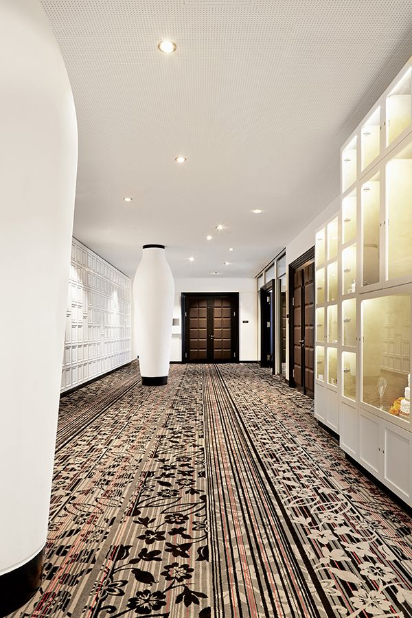 Brintons partnered with global design guru,Marcel Wandersand tecArchitecture to supply unique  carpets for the spectacularKameha Grand Zurichin Switzerland. The hotel's interior is inspired by Swiss culture. You'll even find chocolate patterned walls and doors! #CarpetDesign #Inspiration #InteriorInspiration #Interiors #CustomCarpet #CommercialCarpet #CarpetIdeas #HotelCarpet #Hotel #Switzerland