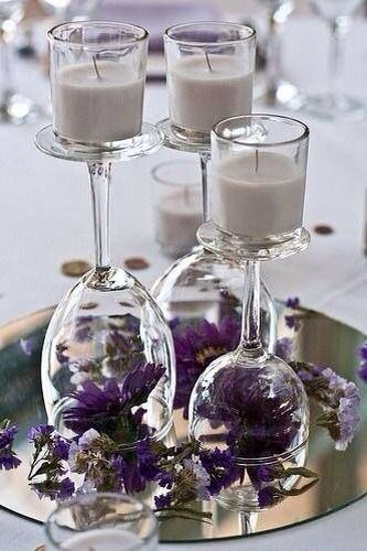 Candles sitting on upturned wine glasses