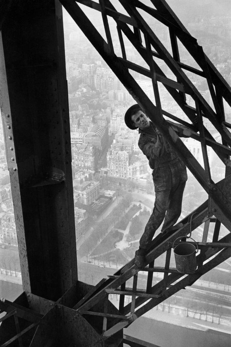 Marc Riboud // Painting the Eiffel Tower, Paris, 1953.