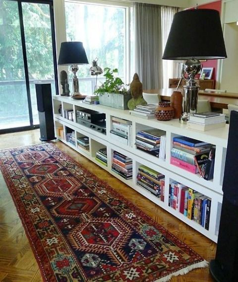 Back-of-the-couch console table/shelving  --   stack IKEA's $20 Lack bookcases behind the couch to create a console table/ storage space.  There are various other shelves available on the Ikea site that can be flipped horizontally to achieve this look