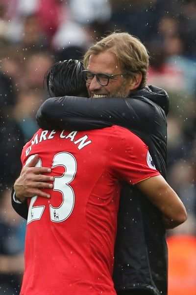 Liverpool's German manager Jurgen Klopp (R) embraces Liverpool's German midfielder Emre Can (L) at the end of the English Premier League football match between Swansea City and Liverpool at The Liberty Stadium in Swansea, south Wales on October 1, 2016. / AFP / GEOFF CADDICK / RESTRICTED TO EDITORIAL USE. No use with unauthorized audio, video, data, fixture lists, club/league logos or 'live' services. Online in-match use limited to 75 images, no video emulation. No use in betting, games or…