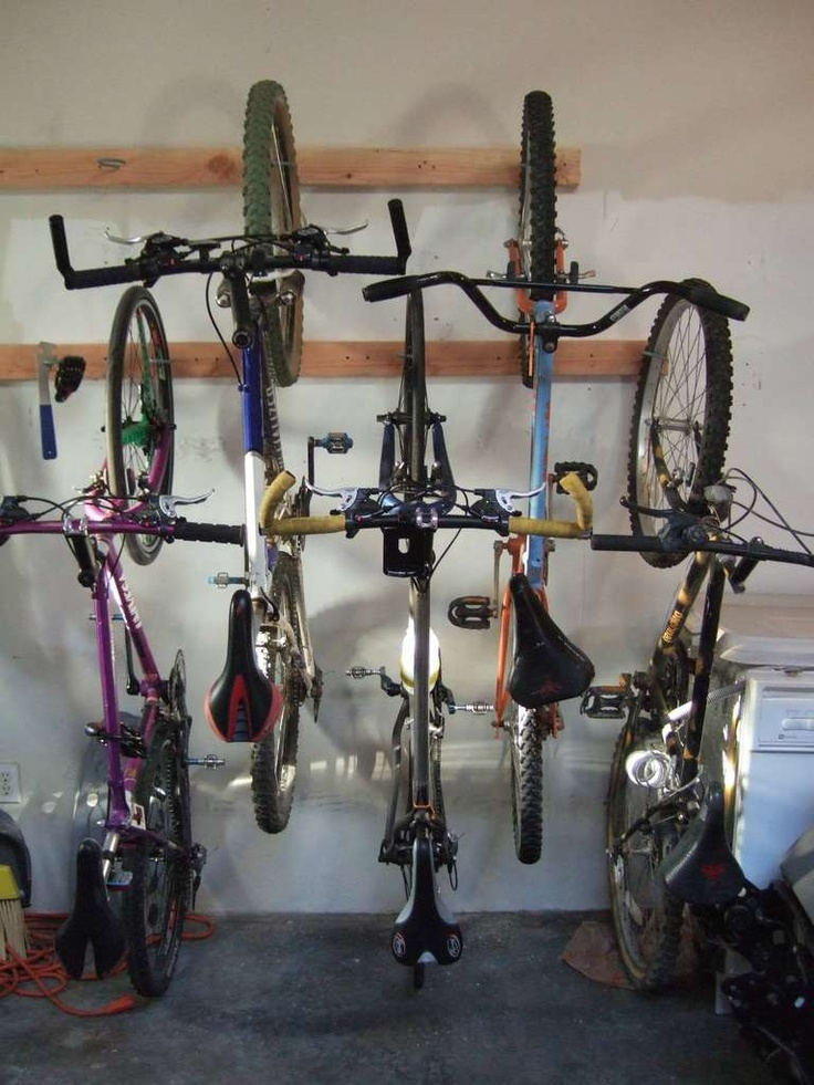 diy bike storage system (andies notes)  In the pallet shed have a row across the top for the big kids, and a lower one with them spaced for the little kids!  Buddies lock their bikes together :)