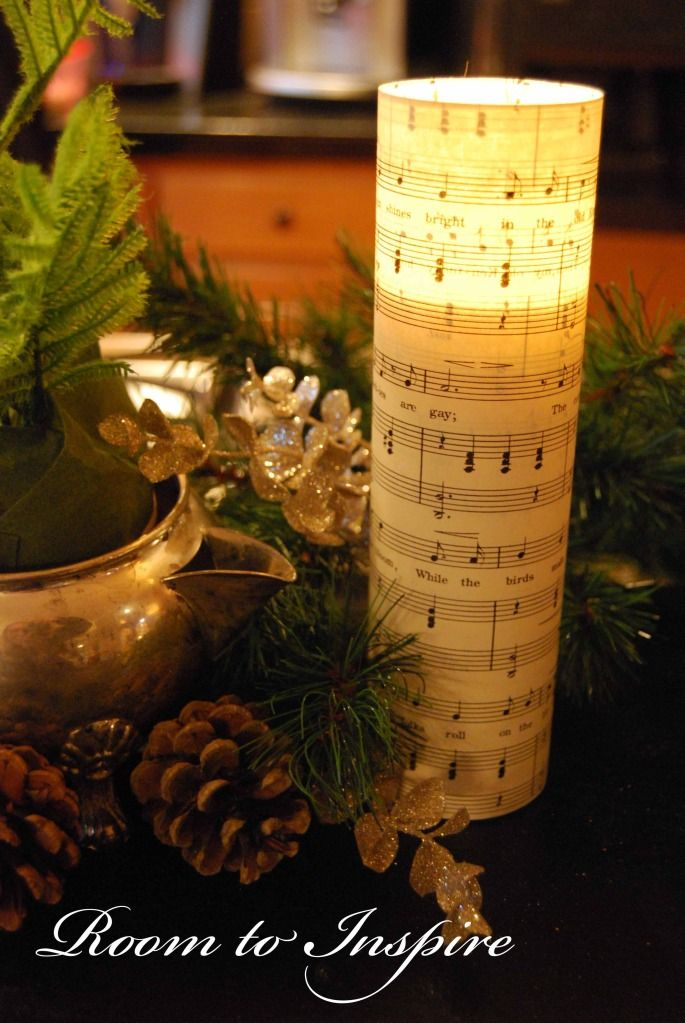 Sheet Music candle.  Dollar Store glass column with candle.  Cut sheet music and glue with double sided tape or mod podge it on.