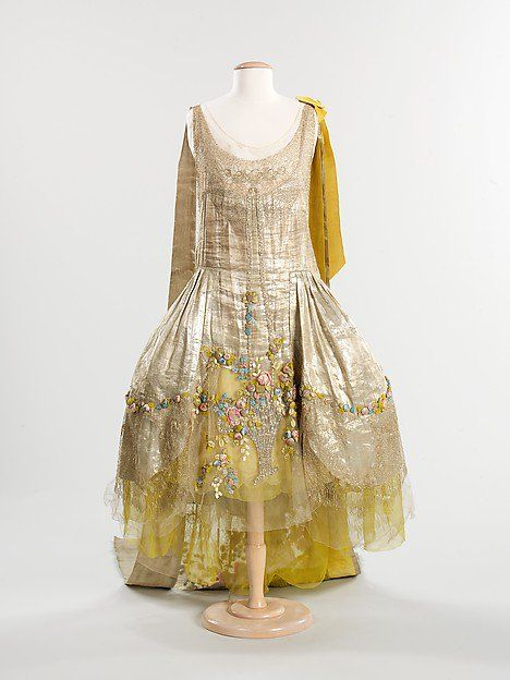 1930's court dress with floral bouquet detailing from the @metmuseum