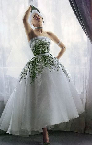 Bettina models an evening dress by Jacques Fath. Photo: Norman Parkinson, Vogue, 1950.