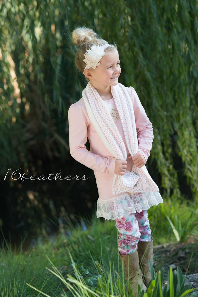 The perfect winter accessory for your little people! These gorgeous handmade scarves feature the soft of softest fleece on the inside and trendy cotton fabrics on the outside! So cosy and lightweight - they are best way to keep them warm this winter.Each is finished with a vintage doily or button. Fits Child size approx 3-12 years.Team with other items from the @Sydney Smith accessory or clothing range.