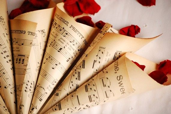 Love this concept from Etsy - Vintage music sheets from the 1920s and 30s made into cones for carrying rose petals, rice or other confetti. They would also be perfect filled with rose petals and used as table decor etc! **Ohhh how gorgeous!!!  This would be perfect for us as well.... maybe this with flowers on some tables instead of a mason jar with flowers... it could be on the tables with song lyrics :)