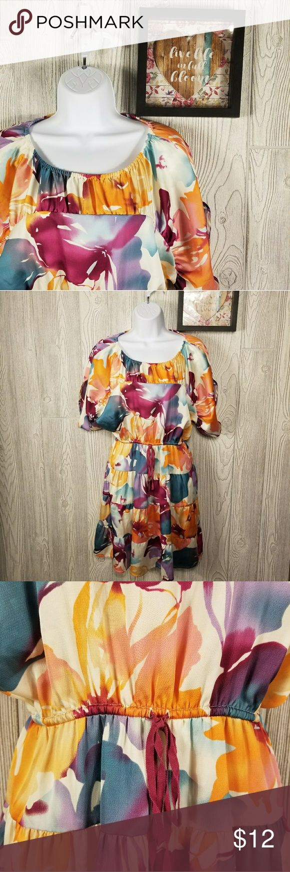 Ann Taylor Loft Floral Dress Ann Taylor Loft Floral Dress Size XXS short sleeve - gather waist Cream, Greens, Oranges and Pinks in color Length form the neck - 30 inches Pit to Pit - 20 inches Elastic waist start at- 23 inches Skirt length of dress from waist - 19 inches  051 Ann Taylor Loft Dresses Midi