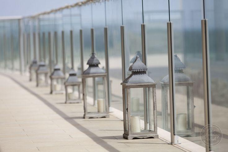Dreamy beach outdoor hurricane lanterns | Sandringham Yacht Club | Concepts & Styling by One Wedding Wish