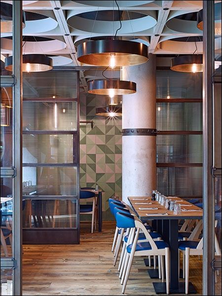 Jamie's Italian, at the Hilton, London Bridge. Designed by Stiff & Trevillion. Ernest Race and Kai Kristiansen chairs along with various bespoke elements by Yoo