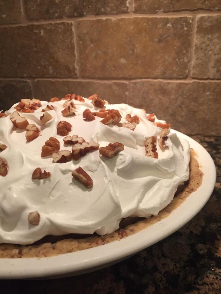 Possum Pie is an Arkansas pie! It has a pecan crust, cream cheese bottom layer, chocolate middle layer and topped with whipped topping and toasted pecans. Delish!