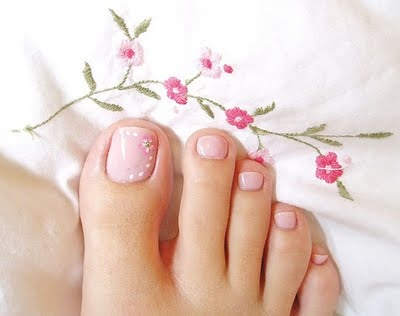 Nude polish with delicate flowers