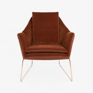 Saba Velvet Chair    Exclusively at ABC, a sleek, low-slung geometric form is softened by padded armrests, seat, and back. Upholstered in sumptuous velvet and accented with a crisp copper frame.