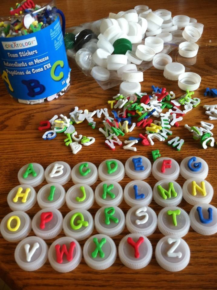 Alphabet stamps with foam stickers and plastic bottle caps.  Just be sure to put the letter on backwards when needed!  So easy!