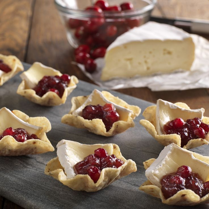Brie & Cranberry Bites in Tostitos Scoops. Ingredients: 1 pkg Brie cheese, finely sliced, 2 cups cranberry sauce, 1 bag Tostitos Scoops!® tortilla chips. Directions: Fill each Scoop with small slice of Brie and bit of cranberry sauce. Serve heated or chilled, as desired.