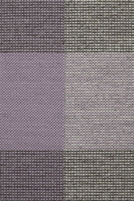 Foster in Wisteria - Thin Felted Wisteria, Undyed Light Gray, and Undyed Loam - Customizable with all yarn colors. Foster is a tonal interplay of toothy weaves in an elegant gingham check pattern. A flatweave rug made from undyed heathered and felted wools, Foster is available in 3 rich colorways: Black, Midnight and Wisteria. The last mill built during Fall River's textile boom, The Foster Spinning Company was added to the National Register of Historic Places in 1983.