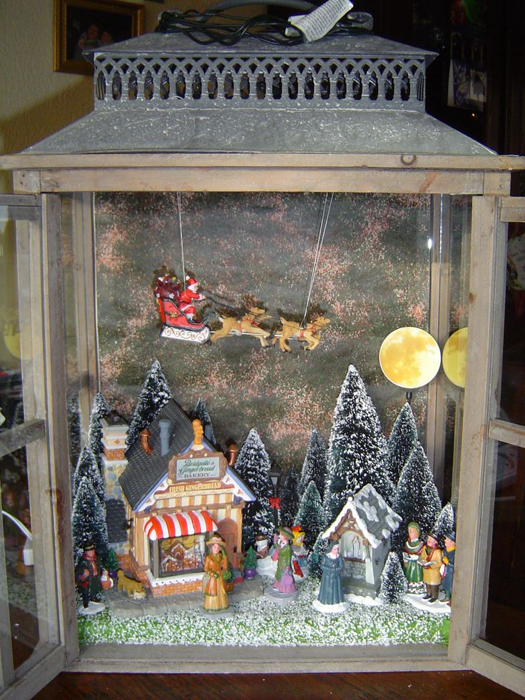 LOVE THIS !!!   A little Dickens Christmas Village in Lantern.