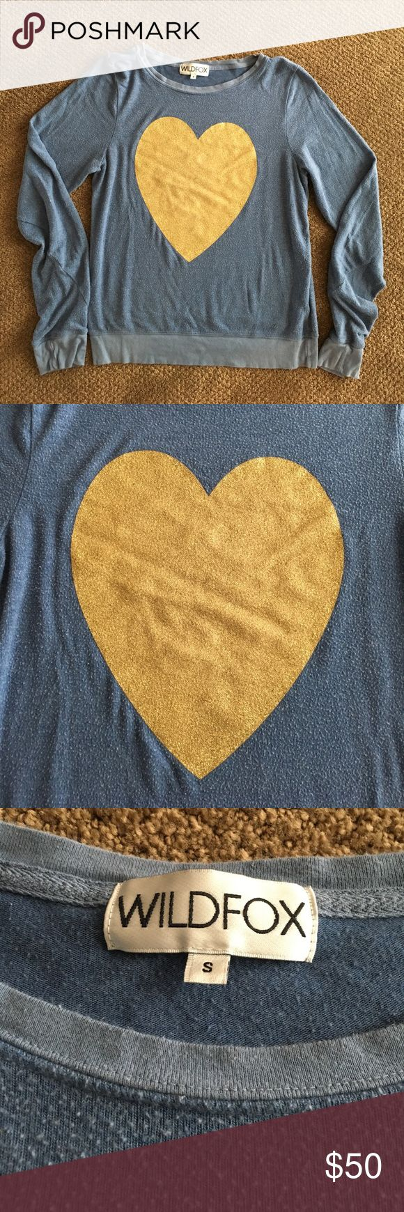 🆕Wildfox Heart Sweatshirt Light blue sweatshirt w gold glitter heart. Some wear but material natural pils (look of these sweatshirts. Made of rayon, spandex and polyester. Pet & smoke free home. Wildfox Tops Sweatshirts & Hoodies
