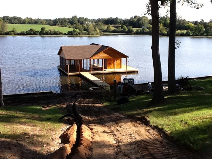 Custom Boathouse with screened porch.  http://stevemartinrealestate.wordpress.com/