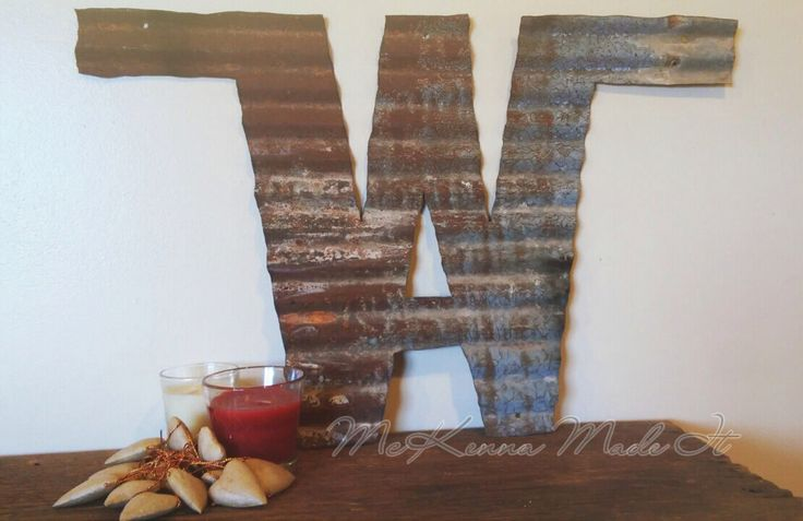 Brand Cut Out of Rusty Barn Tin! Metal Farm Decor, Cattle Brand, Ranch Decor, Porch Decor, Door Decor, Rustic, McKenna Made It, Tin Cut Out by McKennaMadeIt2013 on Etsy https://www.etsy.com/listing/217168292/brand-cut-out-of-rusty-barn-tin-metal
