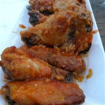 Healthier Restaurant-Style Buffalo Chicken Wings..This is the similar to the hot wings recipe served at a popular restaurant chain. Our healthier version features less butter and no frying!