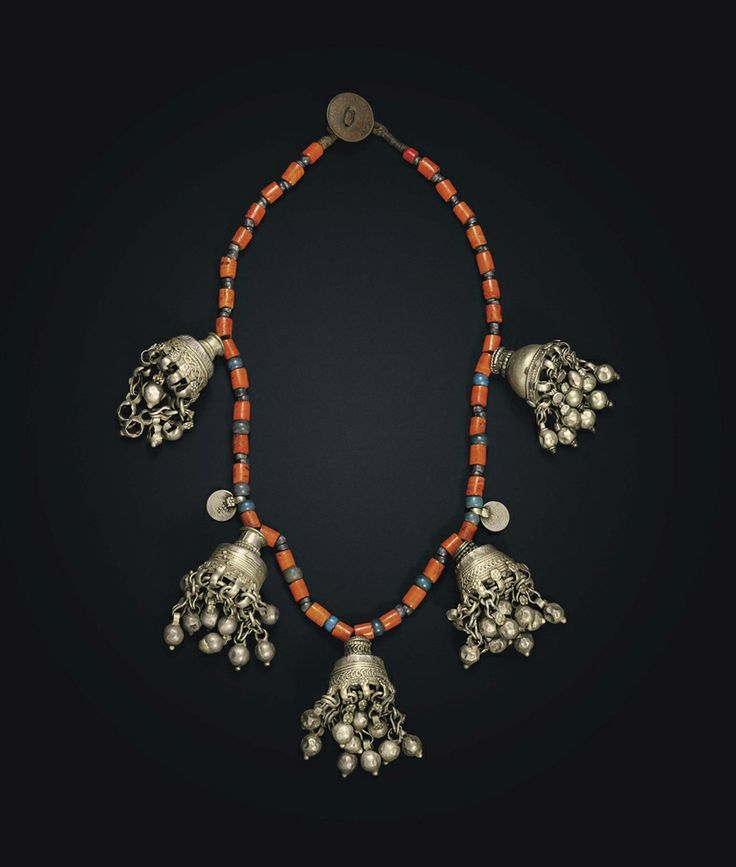 A beaded necklace with silver pendants. India, 20th century