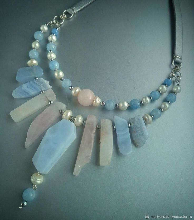 Tiered blue necklace with large rectangular beads.