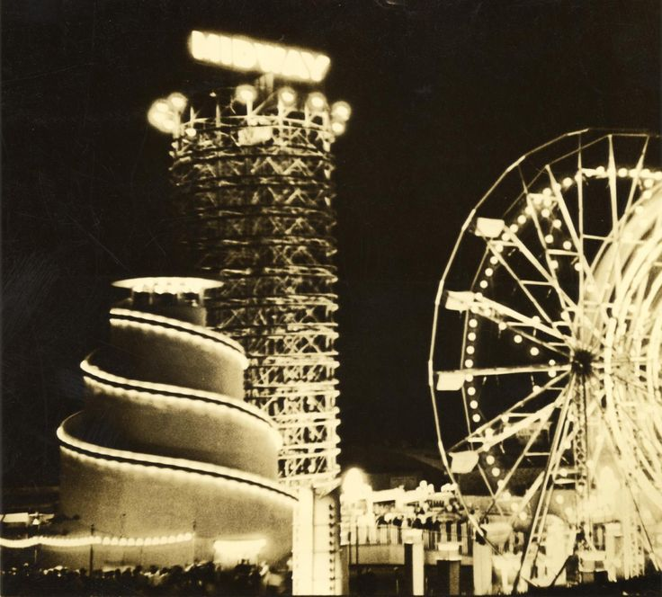 "The Midway, Century of Progress World's Fair, 1933, Chicago (Lou Fowler) | The spiral on the left was a ride called Helter Skelter, where riders would simply climb to the top and slide down. Helter Skelters, named for the British term for ""disorderly haste or confusion,"" had been around since 1905, appearing in many fairs and amusement parks."
