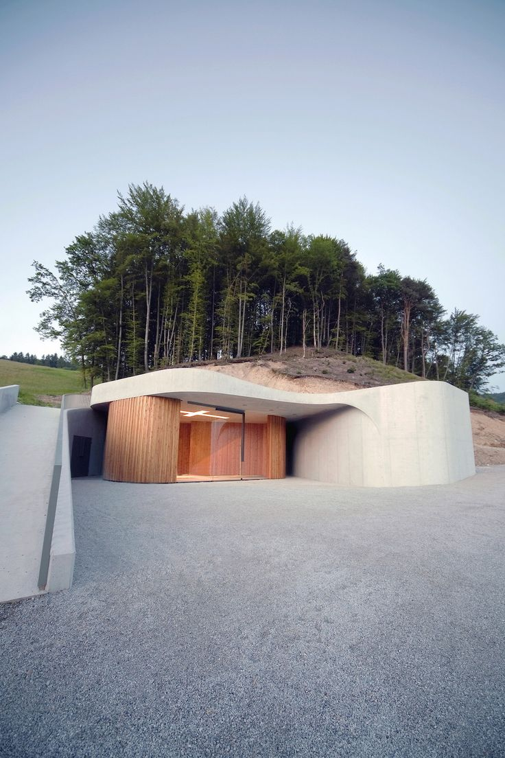 A Curved Concrete Chapel By OFIS Architects – iGNANT.de