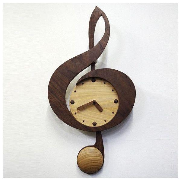 実はト音記号のおたまじゃくし部分が振り子に。 ウォールナットとナラ材のツートンカラーがお洒落な ト音記号の振り子時計(掛け時計)です。