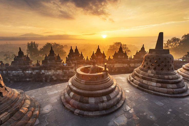 Sunrise above the magical Borobudur temple. Borobudur is the biggest Hindu temple in the world (Kanuman/Shutterstock.com)