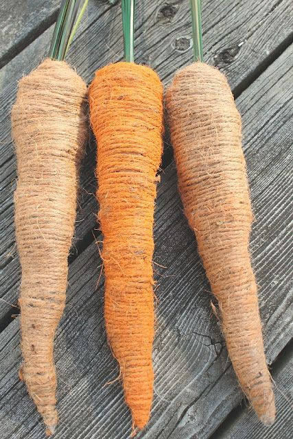 "Prim Burlap Carrots...made with newspaper, fake grassy ""stuff"", tape & twine.  Instructions included."
