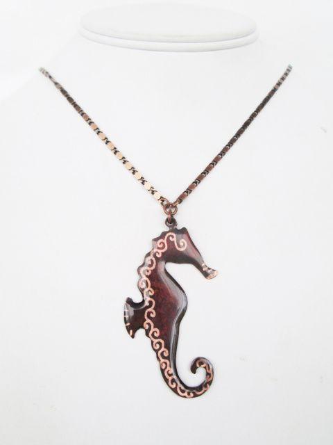 Seahorse Pendant representing 'Strength,' copper symbolic jewelry designed by Canadian artisan Lucya Almeida. #seahorse #beachjewelry #strengthamulet