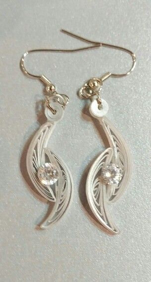 These earrings are made with white paper that is silver edged. They have a 1ct CZ stone in the center. E3