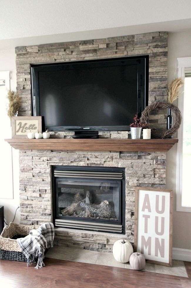 Don't like the arrow like shape of the mantle. Beautiful stacked stone  fireplace - 17 Best Ideas About Stone Fireplace Makeover On Pinterest