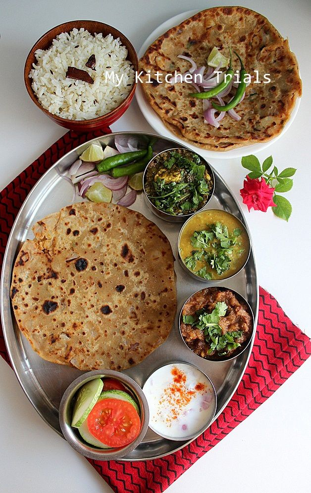 I love Indian food! -J  http://mykitchentrials.wordpress.com/2014/04/23/punjabi-thali-palak-paneer-dal-tadka-chole-aloo-paratha-jeera-rice/
