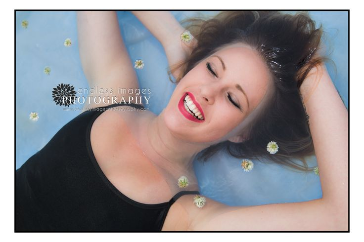 Woman in swimming pool laughs - la crosse Wisconsin photographer - summer photograph - red lipstick www.endlessimagesphotography