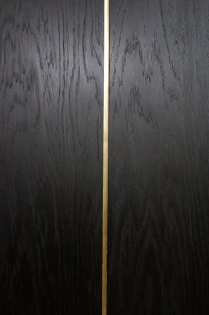 Bog oak parquet with copper insert.