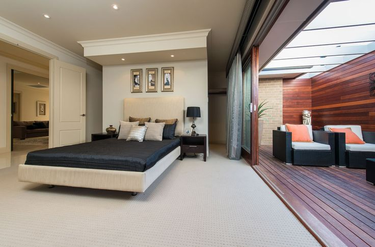 Dream bedroom set up with outdoor area accessed with sliding doors, open top pergola and decking
