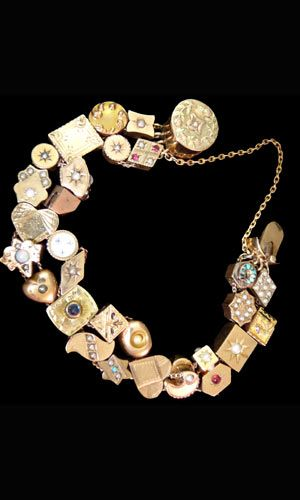 Victorian gold slide bracelet with 29 charms