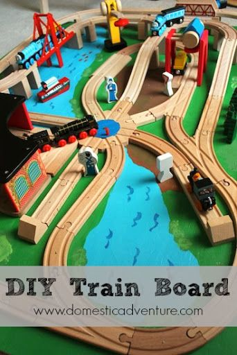 DIY Train Board | Domestic Adventure - Love that she attached the tracks to the board.