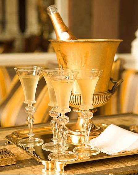 Champagne with vintage glasses, bucket and tray.