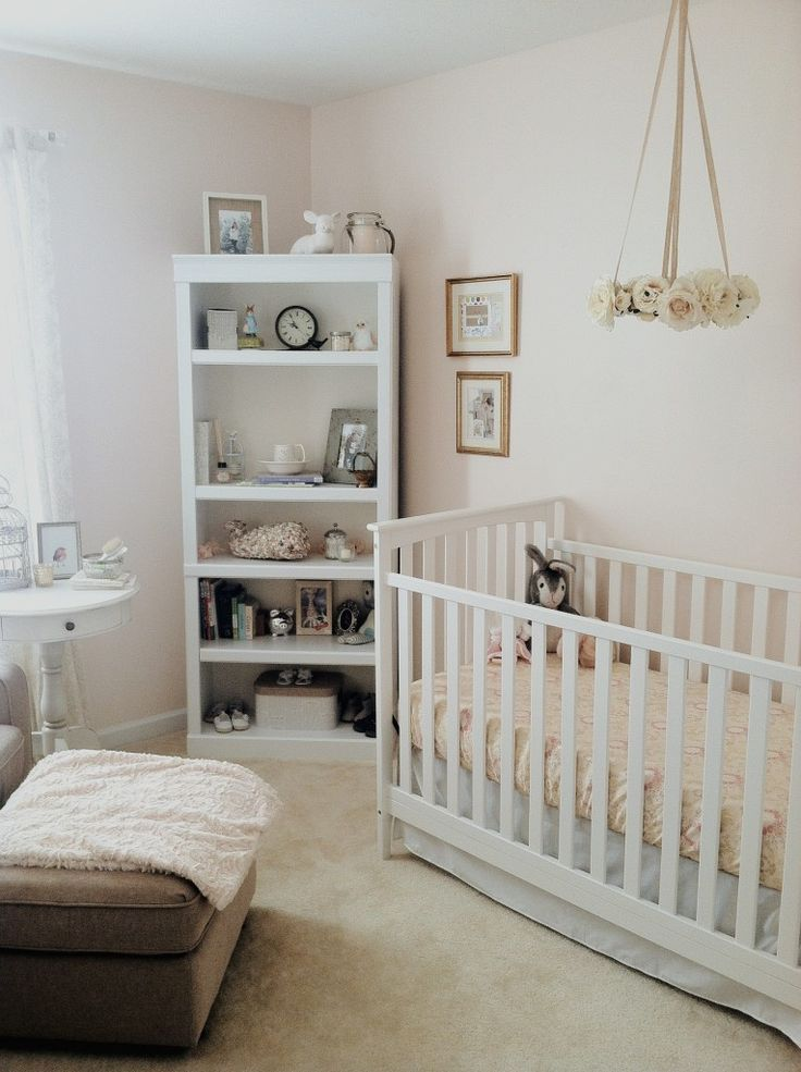 Warm, Rustic and Soft Nursery Baby Girl Nursery - love that sweet floral mobile over the crib!