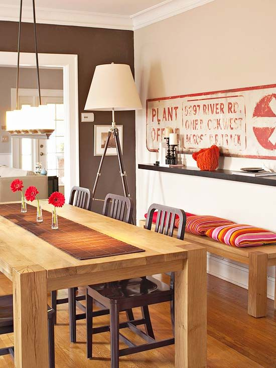 Stylish Flexibility  It's always nice to have extra seating on hand when you're expecting company, but storing extra dining chairs takes up space. This dining room includes a narrow bench topped with pillows, so it's always fashionably dressed and never short on hospitality.