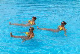 Water aerobics enables you to perform movements and routines similar to those in a traditional aerobics class while keeping your body supported and cushioned from the jarring impact of standard on-ground aerobics moves. You can perform water aerobics in the privacy of your own home in either an above-ground or in-ground pool, as long as the water...