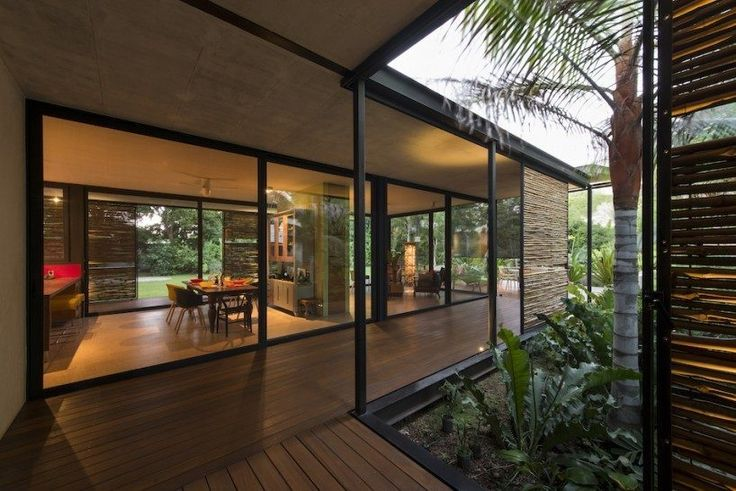 Casa Itzimná, it's breezy—with icovered porches and bamboo-screened indoor-outdoor corridors