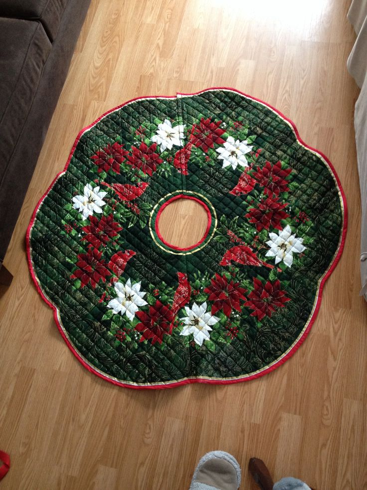 Handmade tree skirt with lined bottom and snap closure for watering tree or adjustments