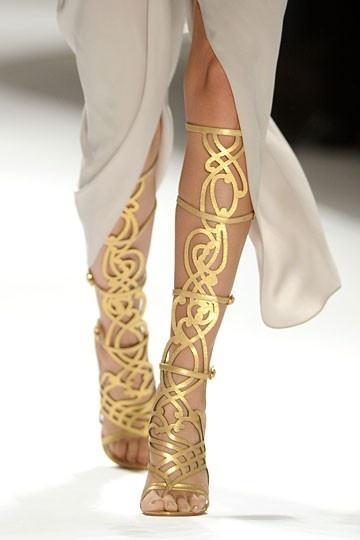 Those shoes remind me of something Circe would wear. I think the gold would represent how rich she was because she took gold and other precious belongs from the men before she turned them to swine.