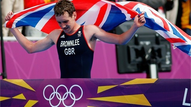 Alistar Brownlee of Great Britain crosses the finish line to win the gold medal in the Men's Triathlon during the Men's Triathlon on Day 11 of the London 2012 Olympic Games at Hyde Park.